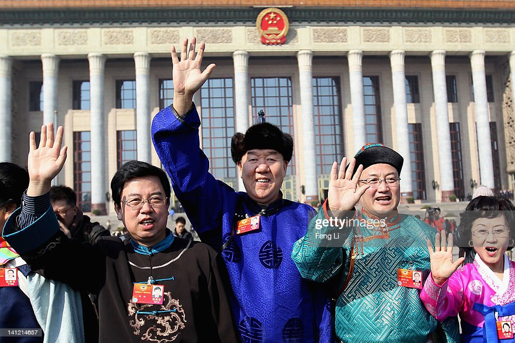 The ethnic minority delegates wave as they leave the closing ceremony of the Chinese People's Political Consultative Conference (CPPCC) at the Great Hall of the People on March 13, 2012 in Beijing, China. Known as 'liang hui,' or 'two organizations', it consists of meetings of China's legislature, the National People's Congress (NPC), and its advisory auxiliary, the Chinese People's Political Consultative Conference (CPPCC).