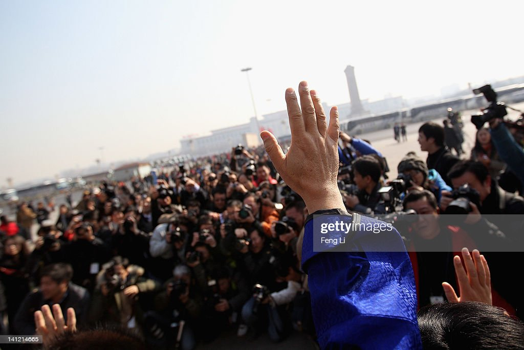 The ethnic minority delegates wave to photographers as they leave the closing ceremony of the Chinese People's Political Consultative Conference (CPPCC) at the Great Hall of the People on March 13, 2012 in Beijing, China. Known as 'liang hui,' or 'two organizations', it consists of meetings of China's legislature, the National People's Congress (NPC), and its advisory auxiliary, the Chinese People's Political Consultative Conference (CPPCC).