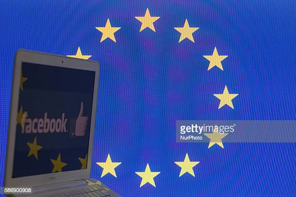 The EU flag is seen with Facebook Logo