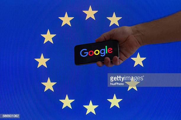 The EU flag is seen with Google logo