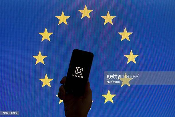 The EU flag is seen with Uber logo