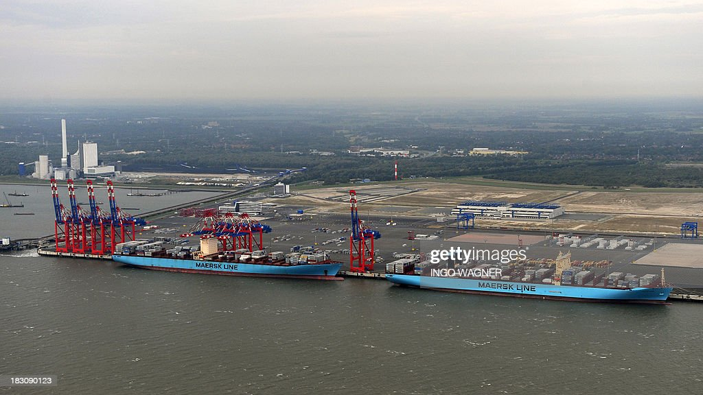The 'Eugen Maersk' container ship (L) and the 'Majestic Maersk' (R) lie at the dock of the JadeWeserPort in Wilhelmshaven,northern Germany on October 4, 2013.