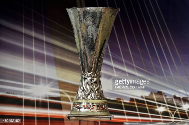 The Europa League trophy stands on a podium during the draw for the UEFA Europa League round of 32 on December 15 2014 at the UEFA headquarters in...
