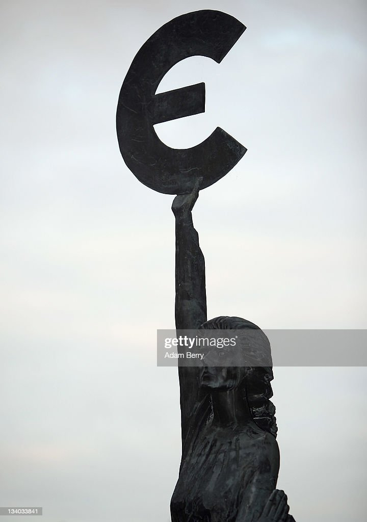 The 'Europe' sculpture by Belgian artist May Claerhout, showing a woman holding up the symbol of the Euro, stands outside the European Parliament building on November 22, 2011 in Brussels, Belgium. Eurozone member countries are continuing to struggle with a debt crisis afflicting a widening circle of nations as the rest of the world fears economic repurcussions.