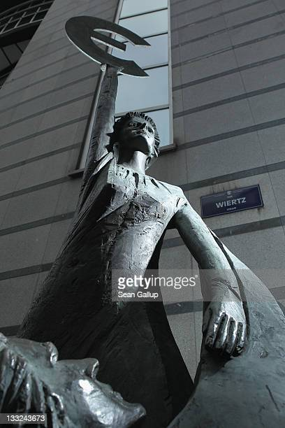 The 'Europe' sculpture of Belgian artist May Claerhout showing a woman holding up the symbol of the Euro stands outside the European Parliament...