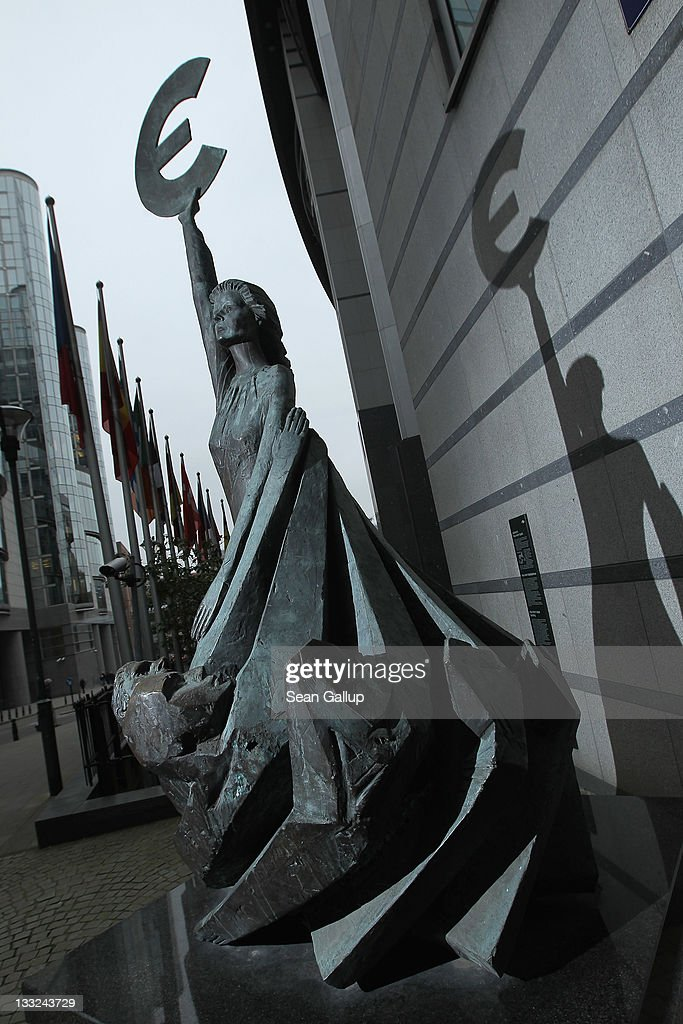 The 'Europe' sculpture of Belgian artist May Claerhout showing a woman holding up the symbol of the Euro stands outside the European Parliament building on November 17, 2011 in Brussels, Belgium. Eurozone member countries are continuing to struggle with a debt crisis afflicting a widening circle of nations as the rest of the world fears economic repurcussions.