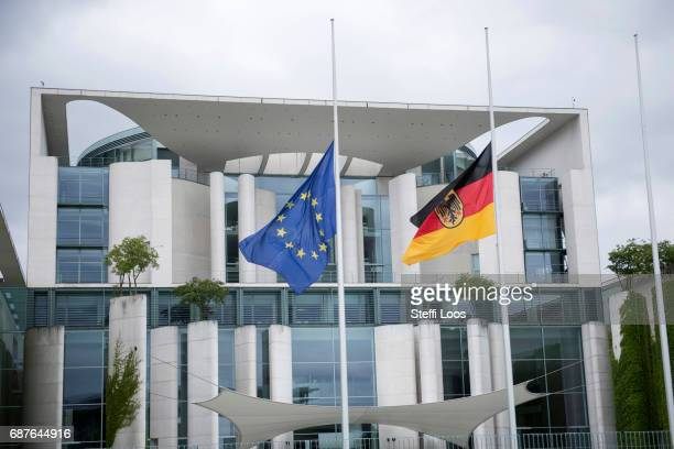 The European and the German flag wave on half mast in front of the chancellery building on May 24 2017 in Berlin Germany An explosion occurred at...