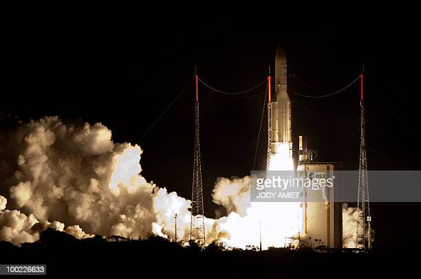 The European Ariane 5 rocket takes off on May 21 2010 in Kourou French Guiana to place two television satellites into orbit the NNS12 for SES World...