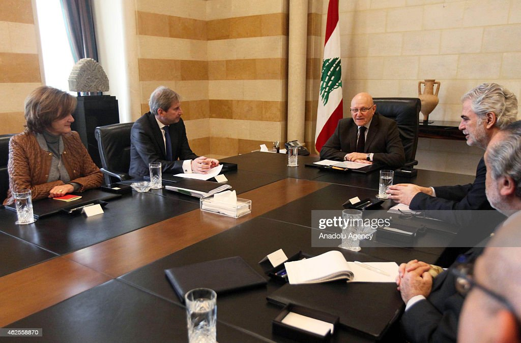 The European Commissioner for Enlargement and European Neighborhood Policy Johannes Hahn (2nd L) and The European Union Commissioner for Humanitarian Aid and Crisis Management Christos Stylianides (3rd R) meets with Lebanese Prime Minister Tammam Salam (C) at prime ministry palace in Beirut, Lebanon on January 31, 2015.