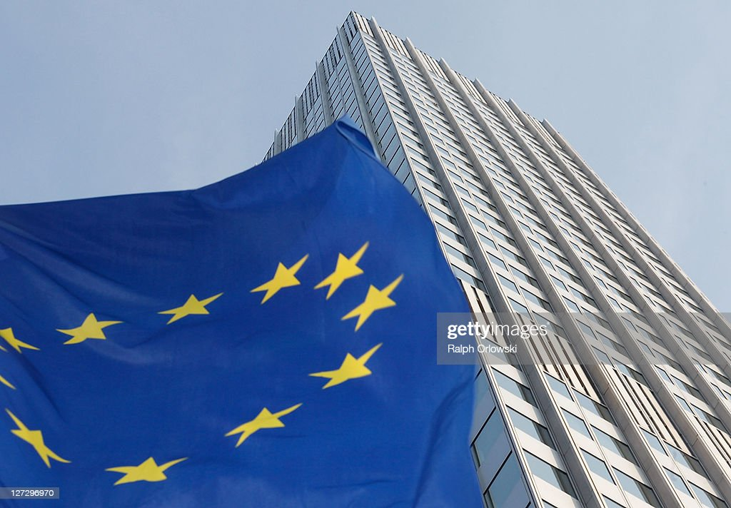 The European flag flatters in the wind past the headquarters of the European Central Bank (ECB) on September 27, 2011 in Frankfurt am Main, Germany. Europe is continuing to wrestle with the ominous prospect of a Greek debt default that many fear could spread panic and push the already fragile economies of Italy, Portugal and Spain into a crisis that would rock the Eurozone and lead to global repercussions. On Thursday the Bundestag, under the urging of German Chancellor Angela Merkel, is expected to pass an increase in funding for the European Financial Stability Facility (EFSF), a measure many see as necessary for financial markets to regain confidence in the European banking system.