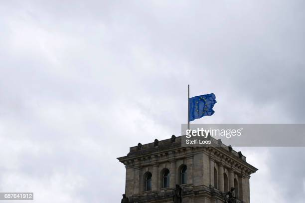 The European flag flies at halfmast on top of the Reichstag building on May 24 2017 in Berlin Germany An explosion occurred at Manchester Arena as...