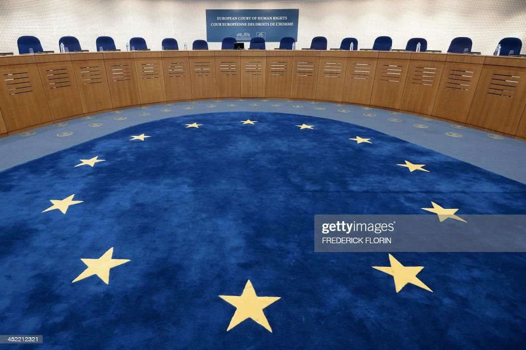The European flag is pictured of the floor of a hearing room prior to the hearing regarding the complaint of a young French Muslim womans challenging France's full-face veil ban at the European Court of Human Rights (ECHR) in Strasbourg, eastern France on November 27, 2013. AFP PHOTO/FREDERICK FLORIN