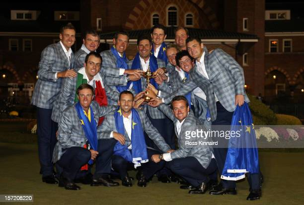 The European Ryder Cup team celebrate with the trophy after the Singles Matches for The 39th Ryder Cup at Medinah Country Club on September 30 2012...