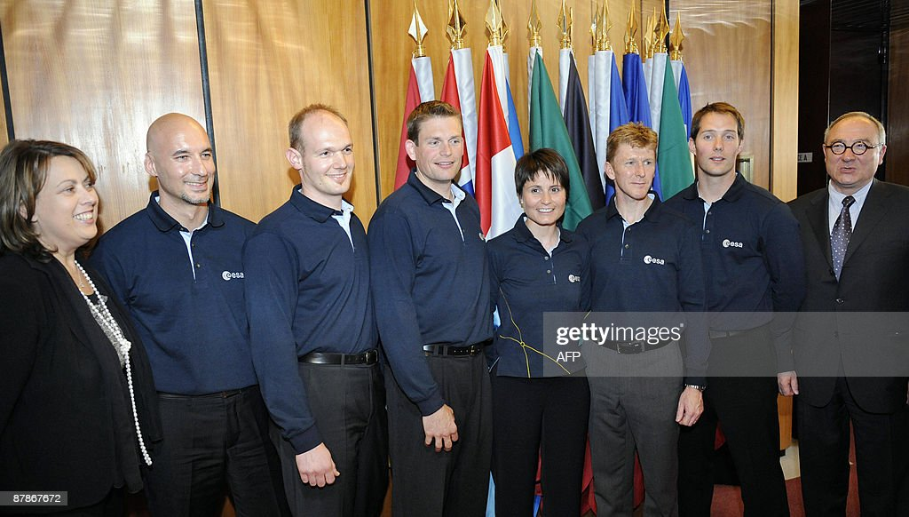 The European Space Agency new astronauts Italian Luca Parmitano (2L), German Alexander Gerst (3L), Danish Andreas Mogensen (4L), Italian Samantha Cristoforetti (C), British <a gi-track='captionPersonalityLinkClicked' href=/galleries/search?phrase=Timothy+Peake&family=editorial&specificpeople=5862798 ng-click='$event.stopPropagation()'>Timothy Peake</a> (3R) and French Thomas Pesquet (2R) pose along with Simonetta Di Pippo, ESA's Director of Human Spaceflight (L) and ESA's director general Jean-Jacques Dordain (R) during a press conference presenting the six new astronauts, selected after a gruelling, year-long vetting process that began with more than 8,400 applicants, at the ESA headquarters in Paris, on May 20, 2009. The new recruits range in age 31 to 37 years old, and are the first to join the European Astronaut Corps since 1992. This is only the second selection process ever carried out by the ESA.