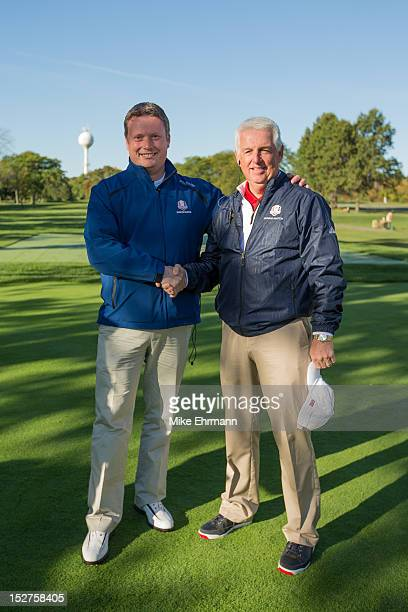 The European Team Captain Stuart Wilson of Scotland and the United States Team Captain Roger Warren shake hands during the morning foursomes for the...