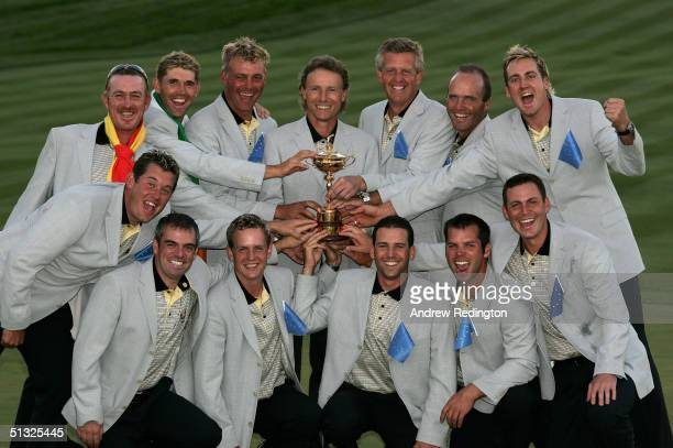 The European team celebrate with the trophy after Europe's victory over the USA at the 35th Ryder Cup Matches at the Oakland Hills Country Club on...