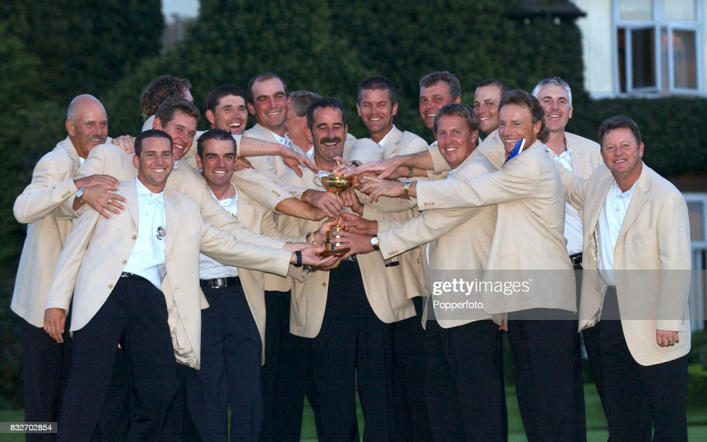 The European Team celebrate with the trophy after their 151/2 to 121/2 Ryder Cup victory over Team USA at The Belfry on September 29th 2002 Left to...
