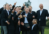 The European team celebrates as Europe retain the Ryder Cup during the Singles Matches of the 2014 Ryder Cup on the PGA Centenary course at the...