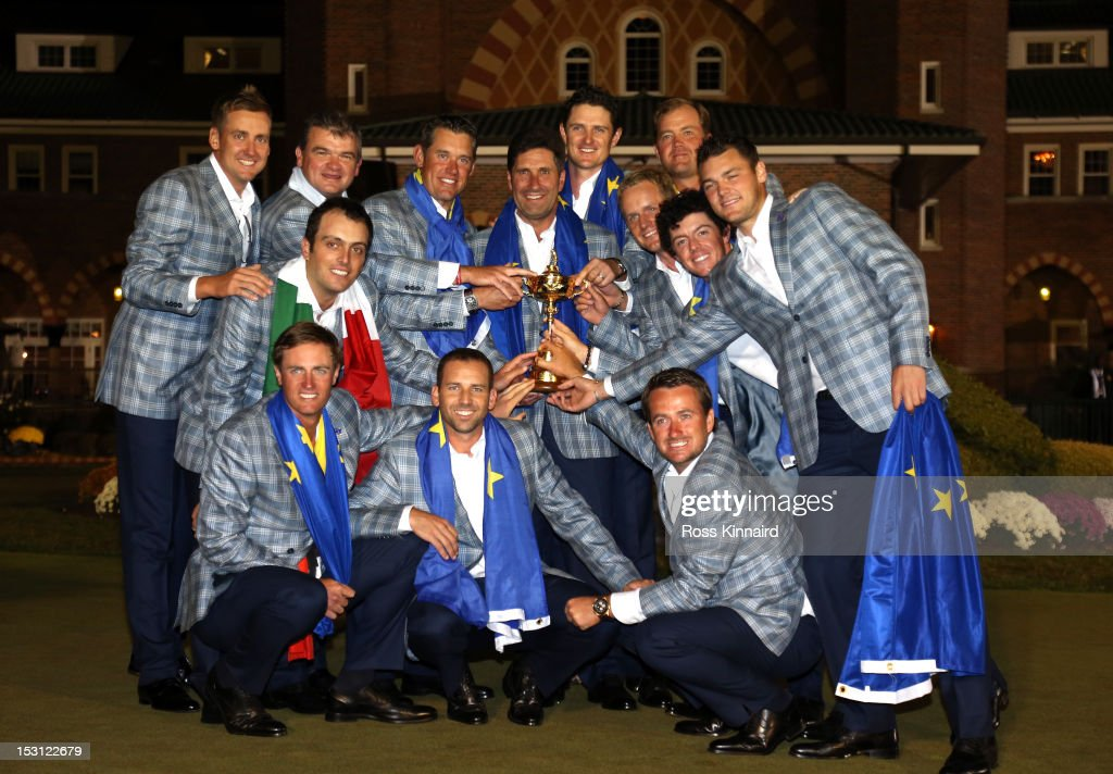 The European team poses with the Ryder Cup after Europe defeated the USA 14.5 to 13.5 at The 39th Ryder Cup at Medinah Country Club on September 30, 2012 in Medinah, Illinois.