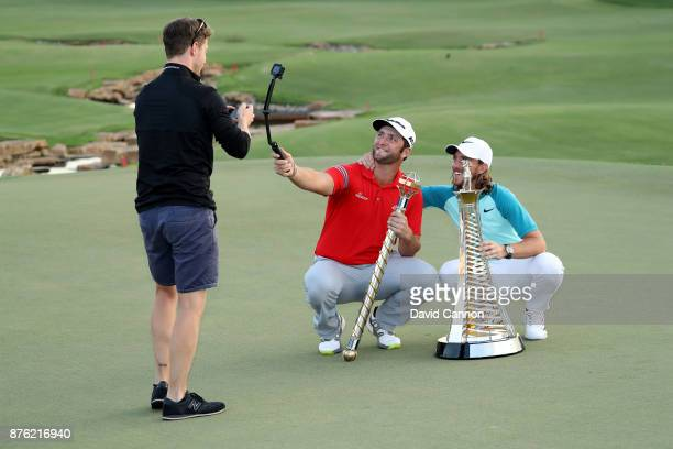 The European tour media team take a 'selfie' video of Jon Rahm of Spain with the DP World Tour Championship trophy and Tommy Fleetwood of England...