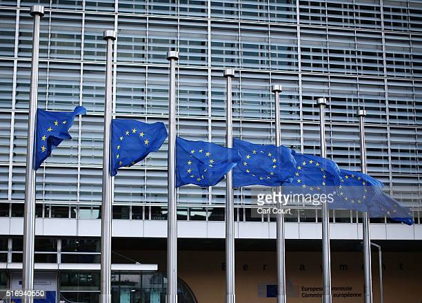 The European Union flag flies at half mast outside EU Commission Headquarters following todays attack on March 22 2016 in Brussels Belgium At least...