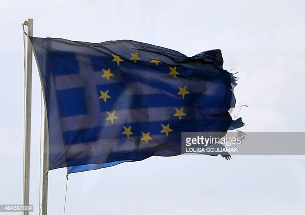 The European Union flag flutters in front of the Greek national flag in Athens on February 25 2015 The hard work for Greece's new antiausterity...