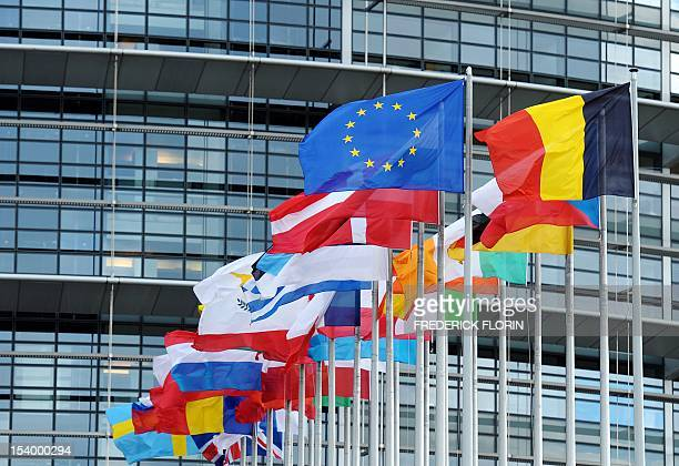 The European Union flag fly amongst European Union member countries' national flags in front of the European Parliament on October 12 2012 in...