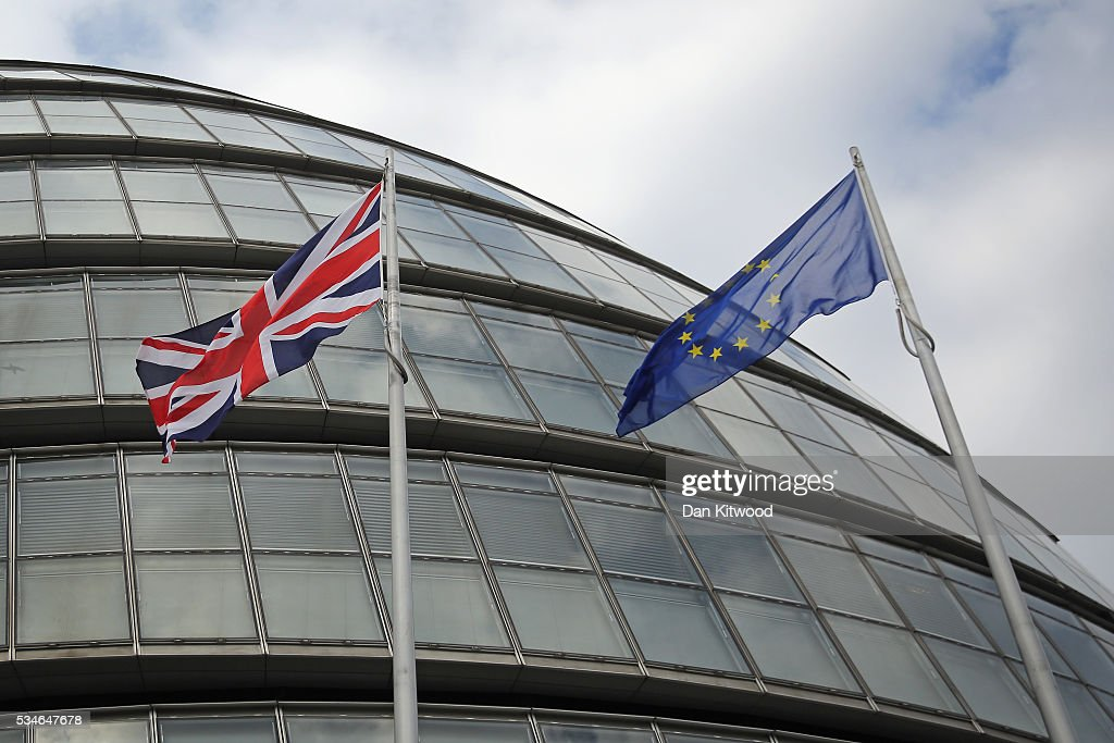 The European Union (EU) flag (R), the British Union flag (C), and the City Hall flag, fly outside City Hall, the headquarters of the Greater London Authority on May 26, 2016 in London, England. The addition of the European Union flag marks the first time it has flown outside City Hall, a change of policy by the new London Mayor, Sadiq Khan.