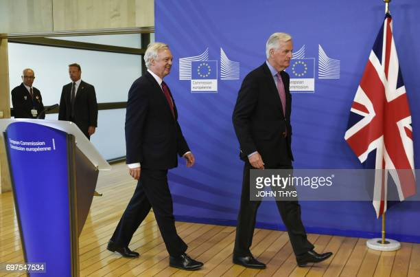 The European Union's chief negotiator Michel Barnier and British Secretary of State for Exiting the European Union David Davis arrive for a joint...