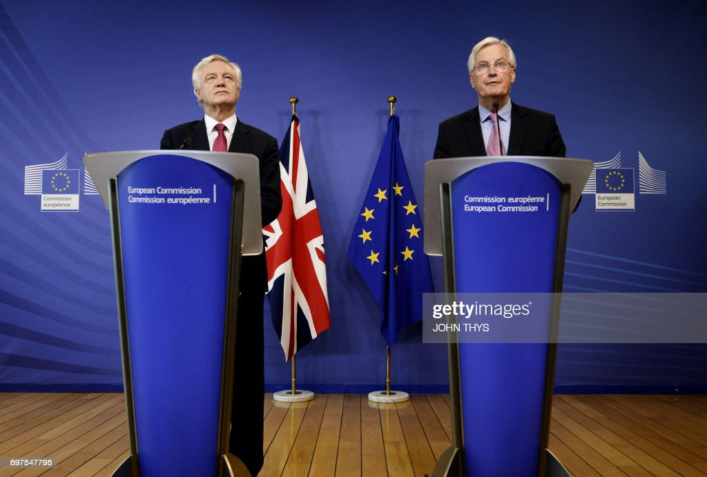 The European Union's chief negotiator Michel Barnier (R) speaks as British Secretary of State for Exiting the European Union (Brexit Minister) David Davis looks on during a joint statement before the opening of Brexit negotiations at the EU headquarters in Brussels on June 19, 2017. The European Union's chief negotiator Michel Barnier on June 19, 2017 said he hoped for a 'constructive' start to Brexit talks with Britain as formal negotiations began in Brussels.'I hope that today we can identify priorities and a timetable that would allow me to report to the (EU summit) later this week that we had a constructive opening of the negotiations,' the Frenchman said as he greeted Britain's Brexit minister David Davis. THYS