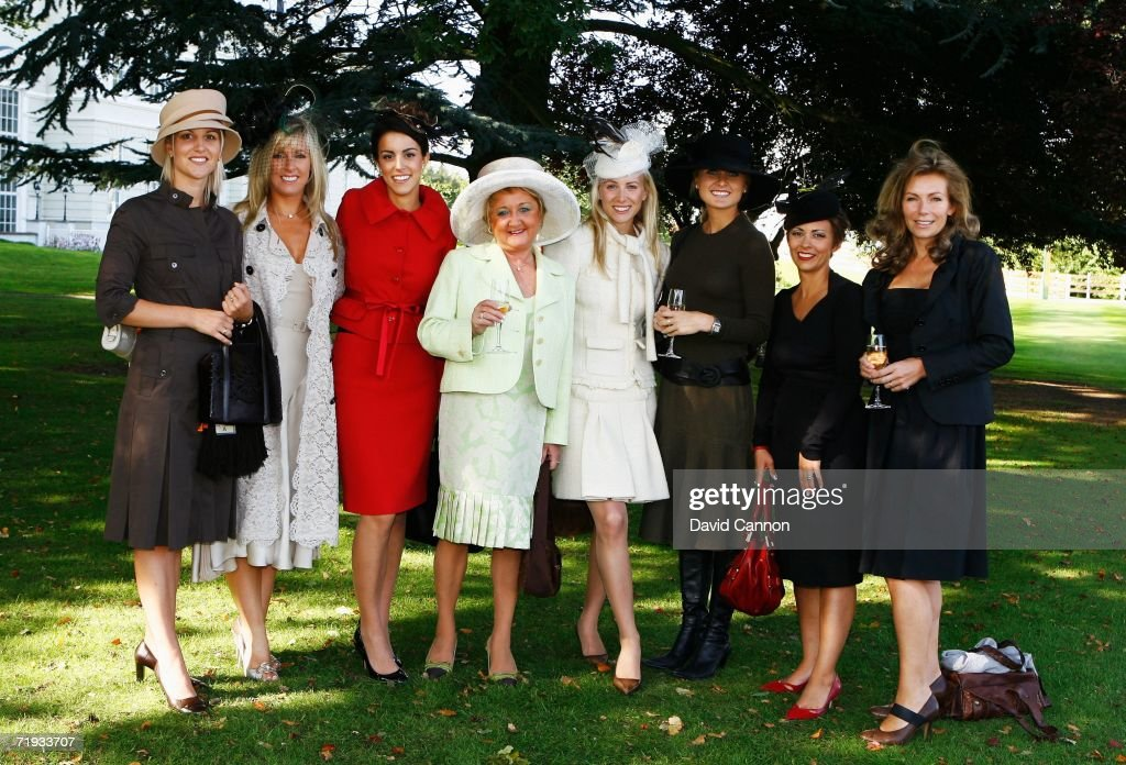 The European Wives and Girlfriends (L-R) Emma Lofgren, Caroline Harrington, Diane Antonopoulos, Glendryth Woosnam, Jocelyn Hefner, Morgan Norman, Laurae Westwood and Alison McGinley pose for a group photo as USA and European team wives prepare to travel to The Curragh racecourse for the Wives Race Day prior to the start of the 2006 Ryder Cup at The K Club on September 19, 2006 in Straffan, Co. Kildare, Ireland.