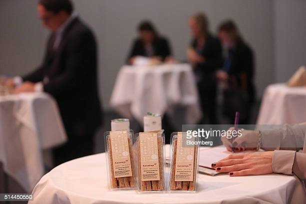 The Eurowings logo sits on inflight meal sandwich packaging as a journalist takes notes during a news conference for Deutsche Lufthansa AG's low cost...