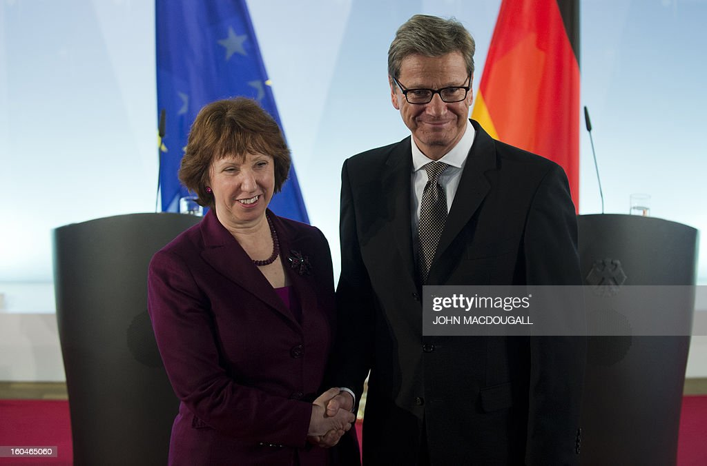 The EU's Foreign Policy Chief Catherine Ashton (L) shakes hands with German Foreign Minister Guido Westerwelle (R) after a press conference following talks with German Foreign Minister Guido Westerwelle at the foreign ministry in Berlin February 1, 2013. AFP PHOTO / JOHN MACDOUGALL