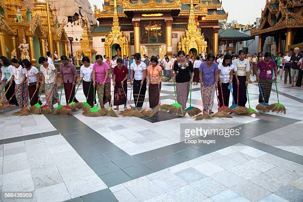 The evening ritual of cleaning the Shwedagon Temple Complex in Yangon in Myanmar