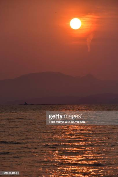 The evening sun on beach and mountains