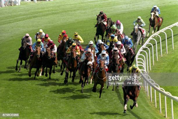 The Ever Ready Derby field rounding Tattenham Corner with Mister Baileys ridden by Jason Weaver leading into the straight with the eventual winner...