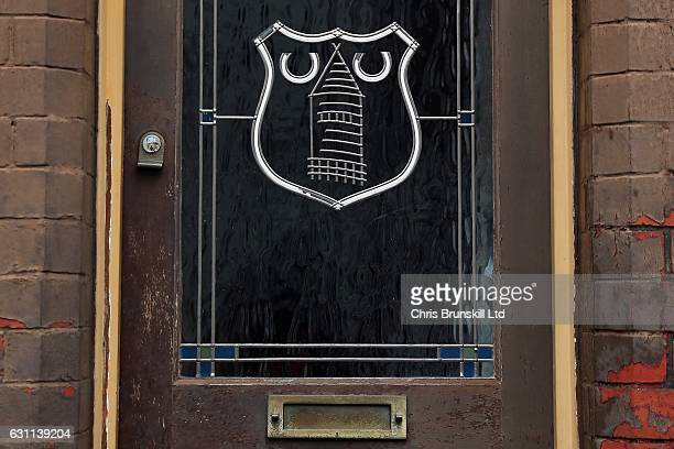 The Everton club crest is seen on the door of a house outside the stadium ahead of the Emirates FA Cup Third Round match between Everton and...