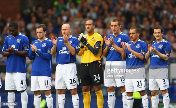 The Everton players observe a minutes applause for mudered young Everton fan Rhys Jones prior to the Barclays Premier League match between Everton...