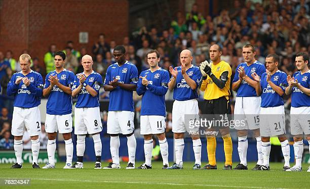 The Everton players observe a minutes applause for murdered young Everton fan Rhys Jones prior to the Barclays Premier League match between Everton...