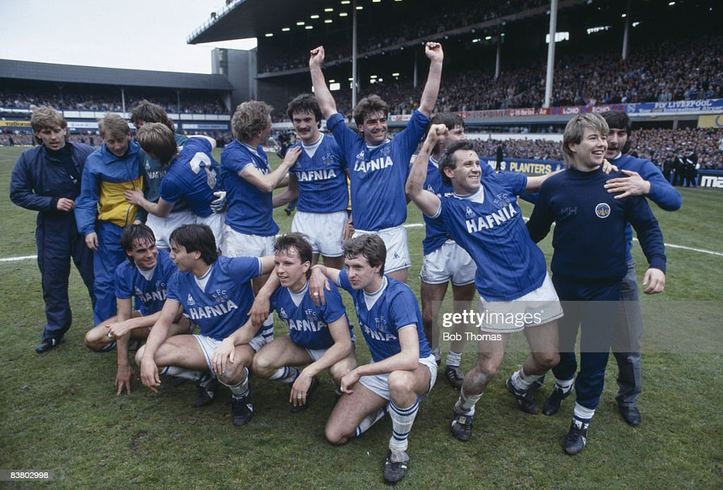 The Everton team celebrate after their 20 victory over Queens Park Rangers had clinched the First Division League Championship at Goodison Park 6th...