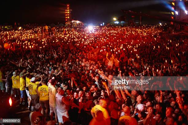 The excited crowd raises their lighters during a performance at Woodstock '99 The concert was celebrating the 30th anniversary of the famed 1969...
