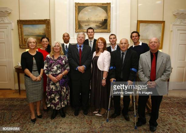 The executive chairman of ITV Michael Grade poses for a portrait with the ten regional winners of the ITV Feelgood Factor Award Geraldine Williams...