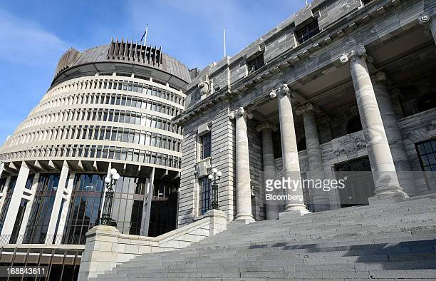 The Executive Wing left and the Parliament House of the New Zealand Parliament Building complex stand in Wellington New Zealand on Thursday May 16...