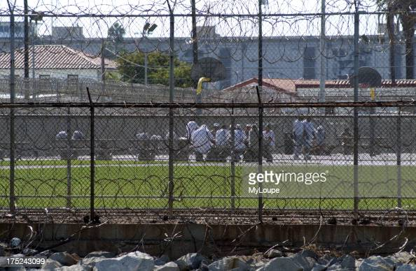 The exercise yard and inmates at the Federal Correctional Institution building on Terminal Island San Pedro Los Angeles California USA