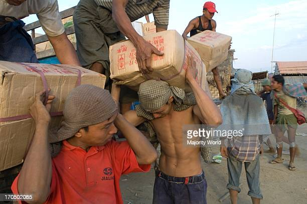 The extent by which Myanmar's economy is dependent on China is immediately evident from the goods being loaded onto the ferry at Bhamo jetty Almost...