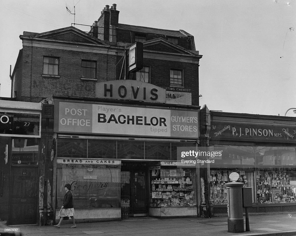 The exterior of a post office and chemist on Clapham High Street London