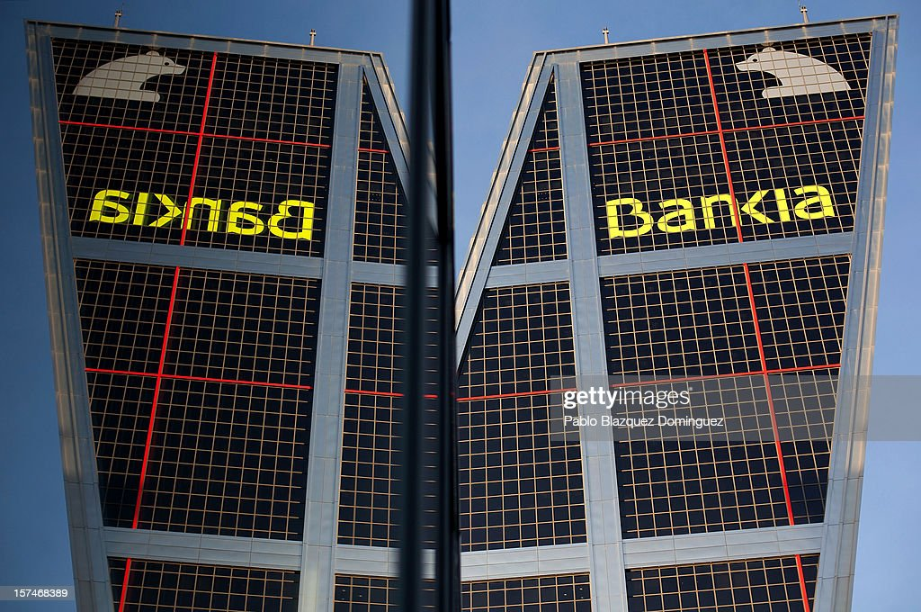 The exterior of the Bankia building at Plaza de Castilla is reflected in a window on December 3, 2012 in Madrid, Spain. Spain has formally requested 39.5 billion euros of European funds to bailout a number of its struggling banks.
