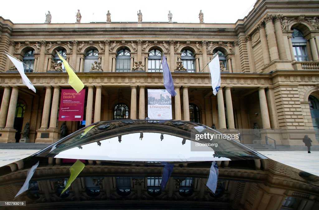 The exterior of the Frankfurt Stock Exchange is reflected in the winsdscreen and bonnet of a limousine parked outside the Bourse in Frankfurt, Germany, on Tuesday, Feb. 27, 2013. Stocks rose, the euro strengthened from a seven-week low and Italian 10-year bonds gained after the country sold 6.5 billion euros ($8.5 billion) of debt amid political turmoil. Photographer: Ralph Orlowski/Bloomberg via Getty Images