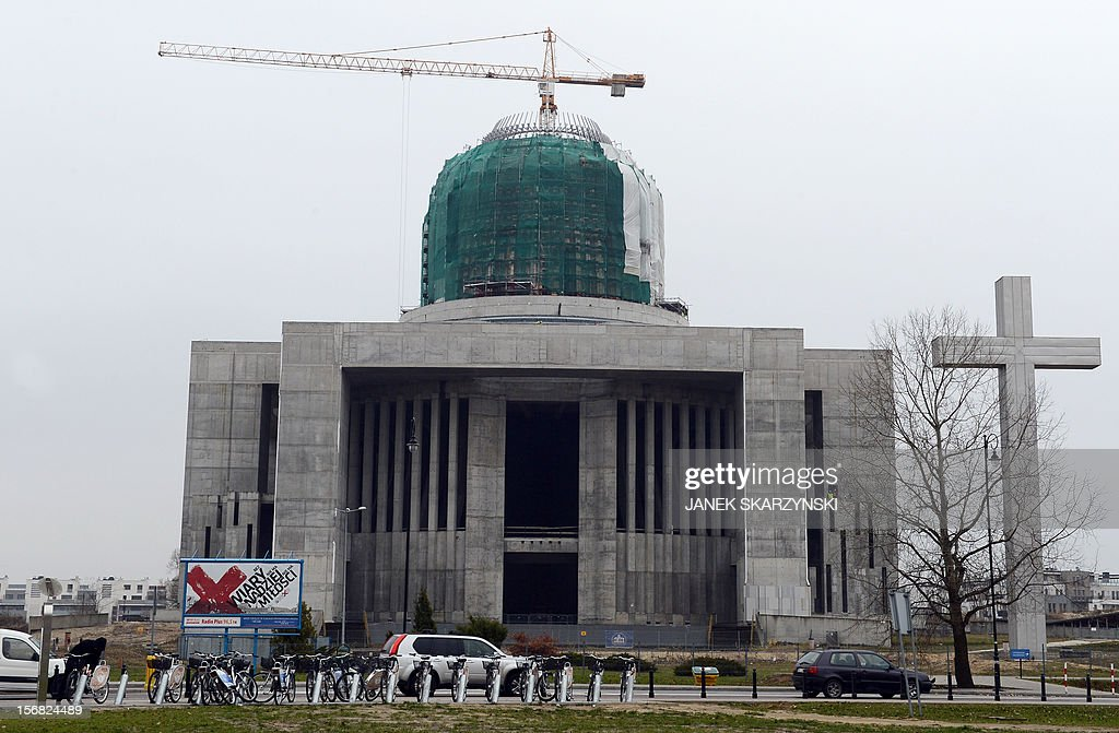The exterior of the Providence Temple in Warsaw is pictured on November 22, 2012. Four victims of the presidential plane crash near the Russian city of Smolensk on April 10, 2010 are buried in temple. It emerged on November 21 the remains of two priests had been mixed up and they had been interred in each other's graves, one at Warsaw's soaring Temple of Divine Providence and the other at a cemetery in the capital's suburb of Pyry. AFP PHOTO/JANEK SKARZYNSKI
