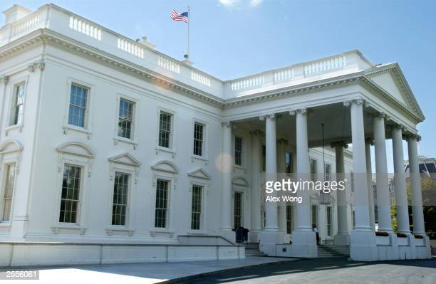 The exterior of the White House is seen October 2 2003 in Washington DC According to a Washington Post/ABC News poll nearly 70% of Americans favored...